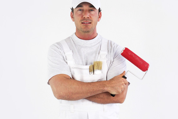 Painter holding roller with red paint
