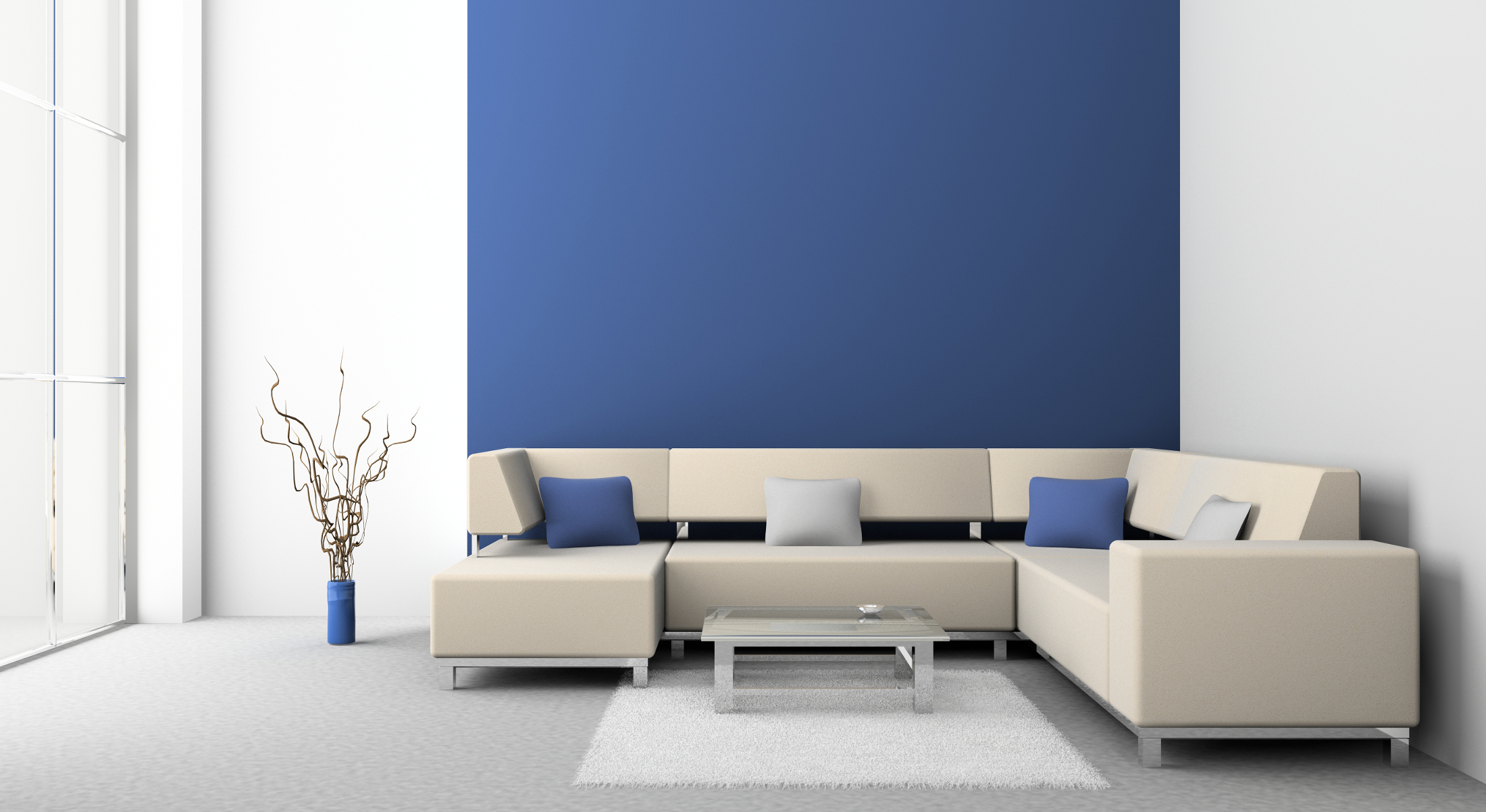White Wall with Blue Area and Tan Sofa